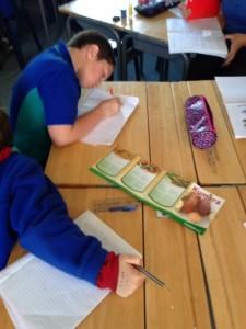 Ben writing his 3 course kumara menu