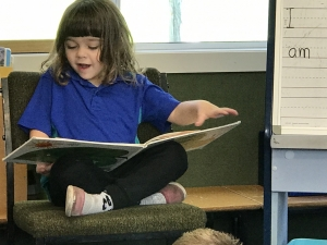 Charlotte reading to Reception room